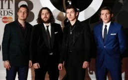 Bowie becomes oldest Brit winner, but Arctic Monkeys steal show