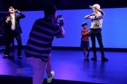 """A child poses for a photo with a waxwork model of Kpop star G-Dragon on the opening day of the first Asian outpost of France's famous waxwork museum, Musee Grevin, in Seoul on July 30, 2015. The new museum's focus is firmly on the world of entertainment and, in particular, stars of the """"Hallyu"""" or """"Korean Wave"""" of pop songs and TV melodramas that have become the country's most potent cultural export. ©AFP PHOTO / Ed Jones"""