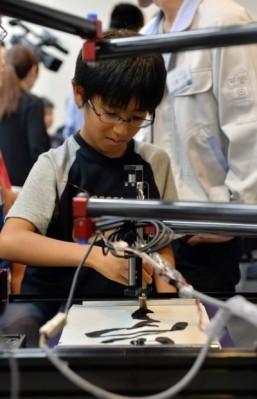 Robot turning Japanese children into master calligraphers