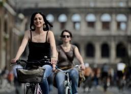 Crisis-hit Italians swap cars for bikes despite perils