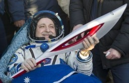 ISS crew returns to Earth with Olympic torch