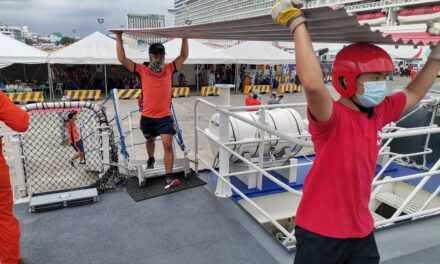 Personnel of the Philippine Coast Guard (PCG) and Philippine Red Cross (PRC) load 500 pieces of galvanized iron sheets