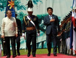 Abe pushes for more active Japanese military