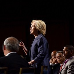 Clinton backs stiffer gun laws after US church bloodbath